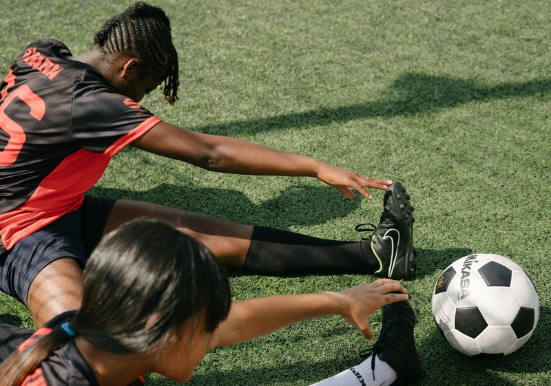 Two girls are doing exercises in football